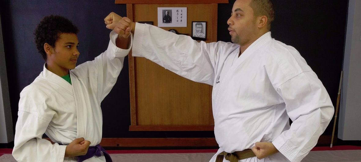 Two students in karate stances.