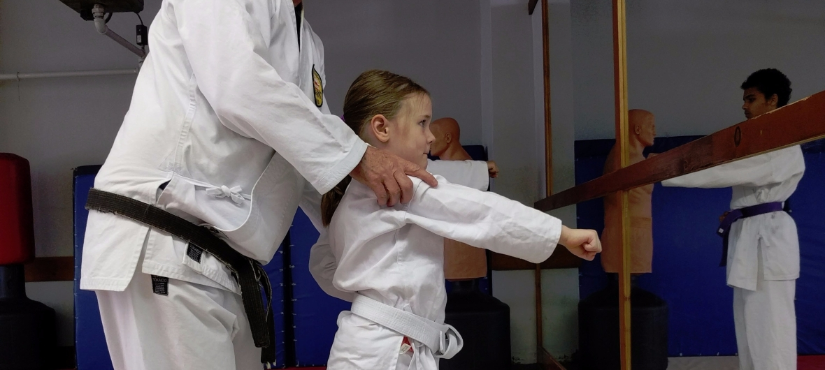 Sensei Steve teaches a young beginner-level girl.